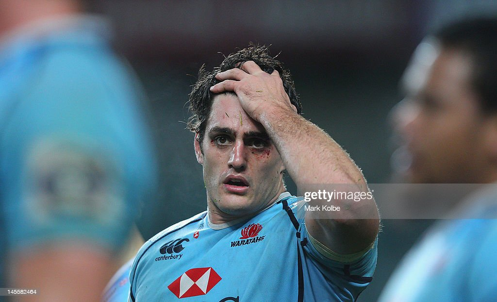 Dave Dennis of the Waratahs looks dejected after losing the round 15 Super Rugby match between the Waratahs and the Hurricanes at Allianz Stadium on June 2, 2012 in Sydney, Australia.