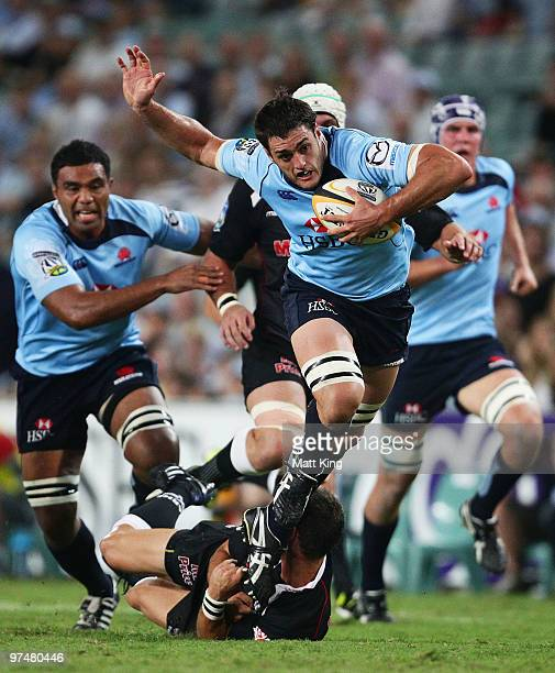 Dave Dennis of the Waratahs makes a break during the round four Super 14 match between the Waratahs and the Blues at Sydney Football Stadium on March...