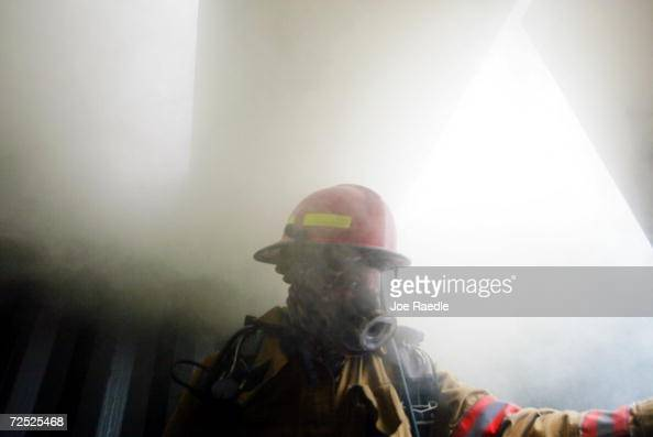 Dave Downey of the MiamiDade firerescue department is engulfed in smoke as he participates in a fire demonstration at the Broward County Fire Academy...