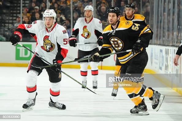 Dave Dziurzynski of the Ottawa Senators skates against Adam McQuaid of the Boston Bruins at the TD Garden on December 29 2015 in Boston Massachusetts