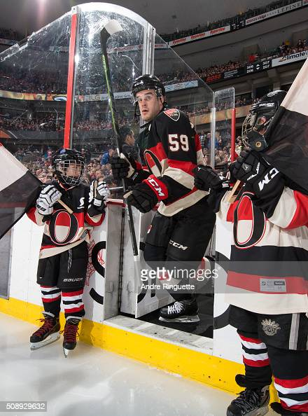 Dave Dziurzynski of the Ottawa Senators steps onto the ice during player introductions prior to a game against the Edmonton Oilers at Canadian Tire...