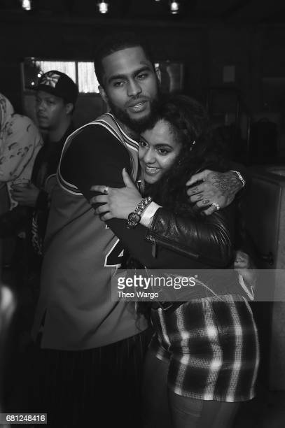 Dave East and Bibi Bourelly hug backstage at the 2017 Def Jam Upfronts presented by Honda Stage Pepsi Courvoisier and True Religion at Kola House NYC...