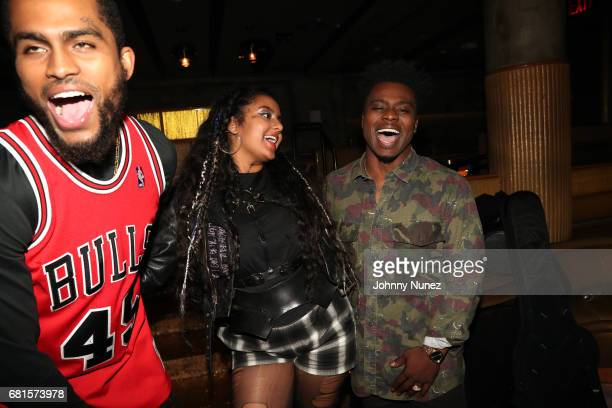 Dave East Bibi Bourelly and Earl St Clair attend the Def Jam Upfronts 2017 showcase at Kola House on May 9 2017 in New York City