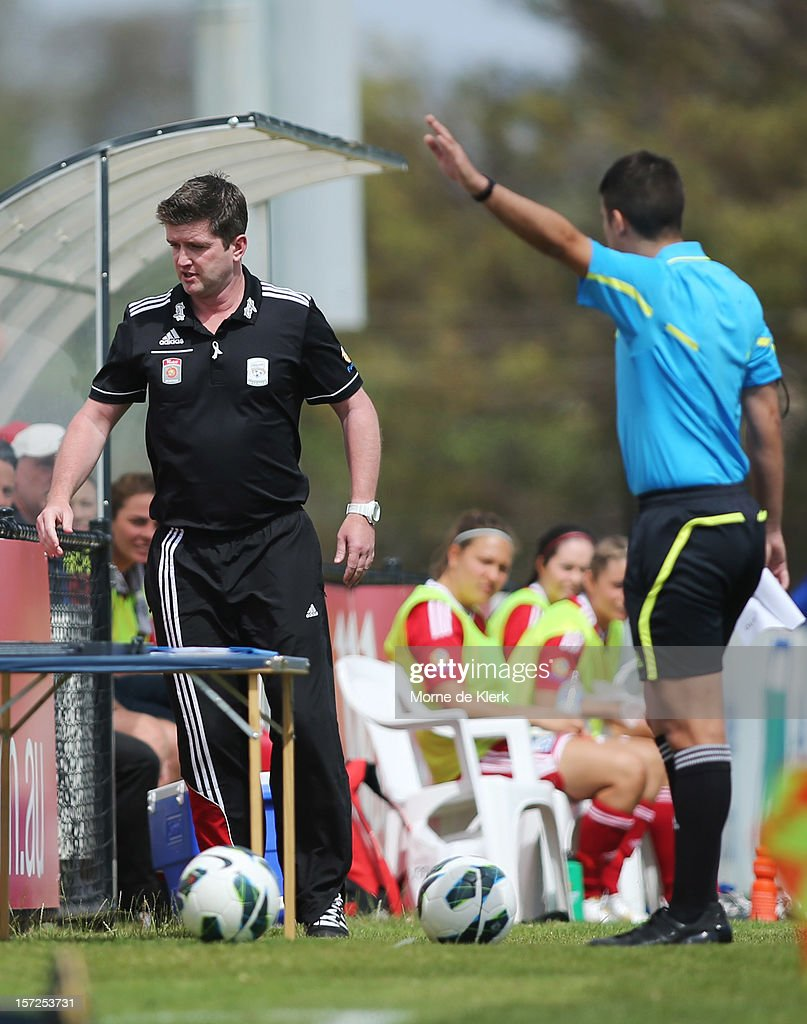 Dave Edmondson of Adelaide is asked by officials to leave the pitch during the round seven W-League match between Adelaide United and the Melbourne Victory at Burton Park on December 1, 2012 in Adelaide, Australia.