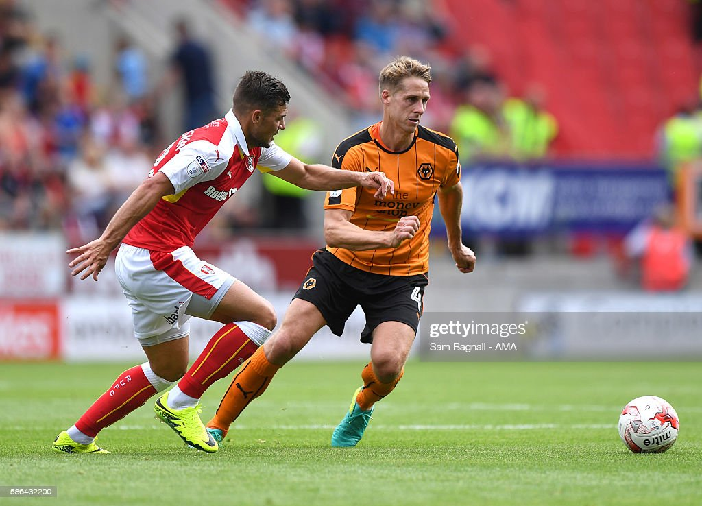 Dave Edwards of Wolverhampton Wanderers and Jake Forster-Caskey of Rotherham United during the Sky Bet Championship match between Rotherham United v Wolverhampton Wanderers at The New York Stadium on August 6, 2016 in Rotherham, England.