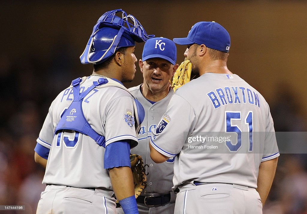 Dave Eiland #58 of the Kansas City Royals speaks with Salvador Perez #13 and Jonathan Broxton #51 on the mound during the ninth inning against the Minnesota Twins on June 29, 2012 at Target Field in Minneapolis, Minnesota. The Royals defeated the Twins 4-3.