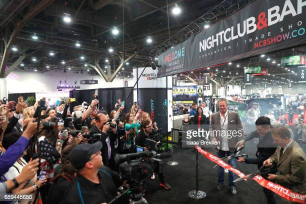 Dave Elger Tom Sandoval and Chairman of the NBC Show Advisory Board Thom Greco cut the ribbon on day two of the 32nd annual Nightclub Bar Convention...