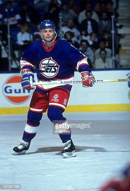 Dave Ellett of the Winnipeg Jets skates on the ice during an NHL game against the New York Islanders on October 16 1990 at the Nassau Coliseum in...