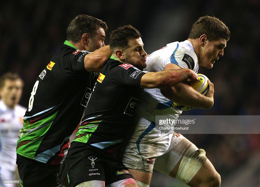 Dave Ewers of Exeter Chiefs looks break away from the tackle from Harlequins duo Danny Care and Nick Easter during the Aviva Premiership match between Harlequins and Exeter Chiefs at Twickenham Stadium on December 28, 2013 in London, England.
