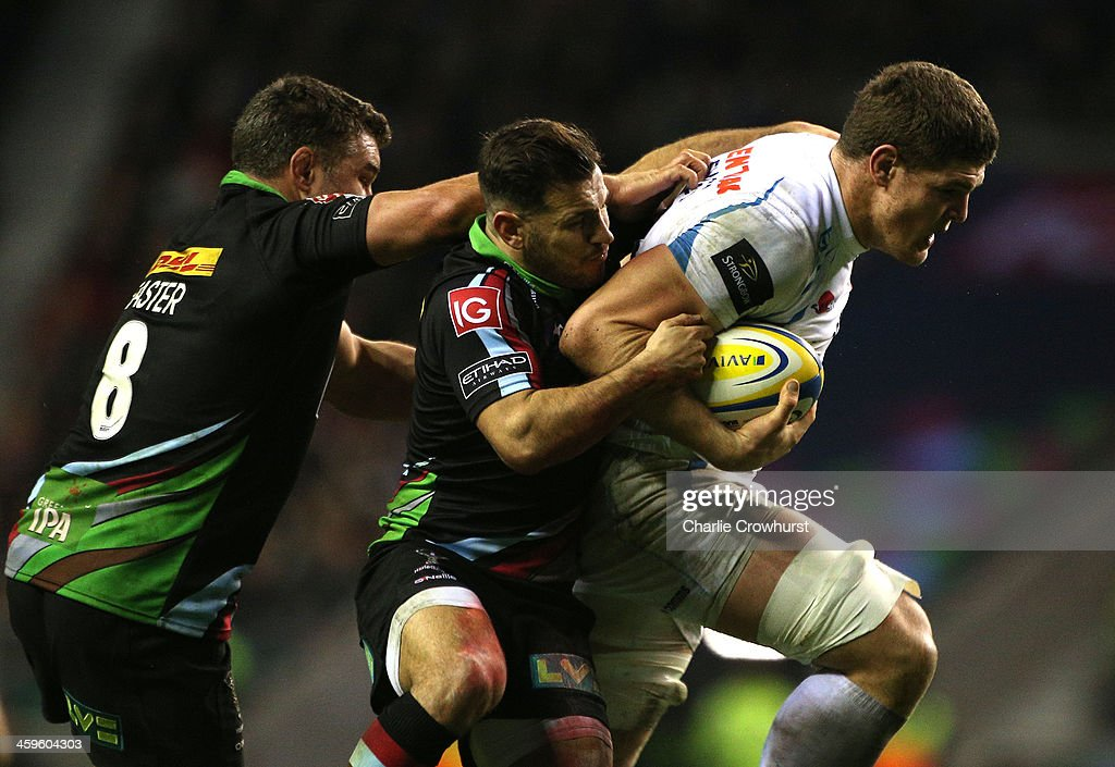 Dave Ewers of Exeter Chiefs looks break away from the tackle from Harlequins duo <a gi-track='captionPersonalityLinkClicked' href=/galleries/search?phrase=Danny+Care&family=editorial&specificpeople=539686 ng-click='$event.stopPropagation()'>Danny Care</a> and <a gi-track='captionPersonalityLinkClicked' href=/galleries/search?phrase=Nick+Easter&family=editorial&specificpeople=686040 ng-click='$event.stopPropagation()'>Nick Easter</a> during the Aviva Premiership match between Harlequins and Exeter Chiefs at Twickenham Stadium on December 28, 2013 in London, England.