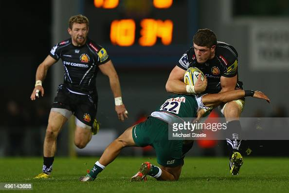 Dave Ewers of Exeter Chiefs powers his way into Peter Betham of Leicester Tigers during the Aviva Premiership match between Exeter Chiefs and...