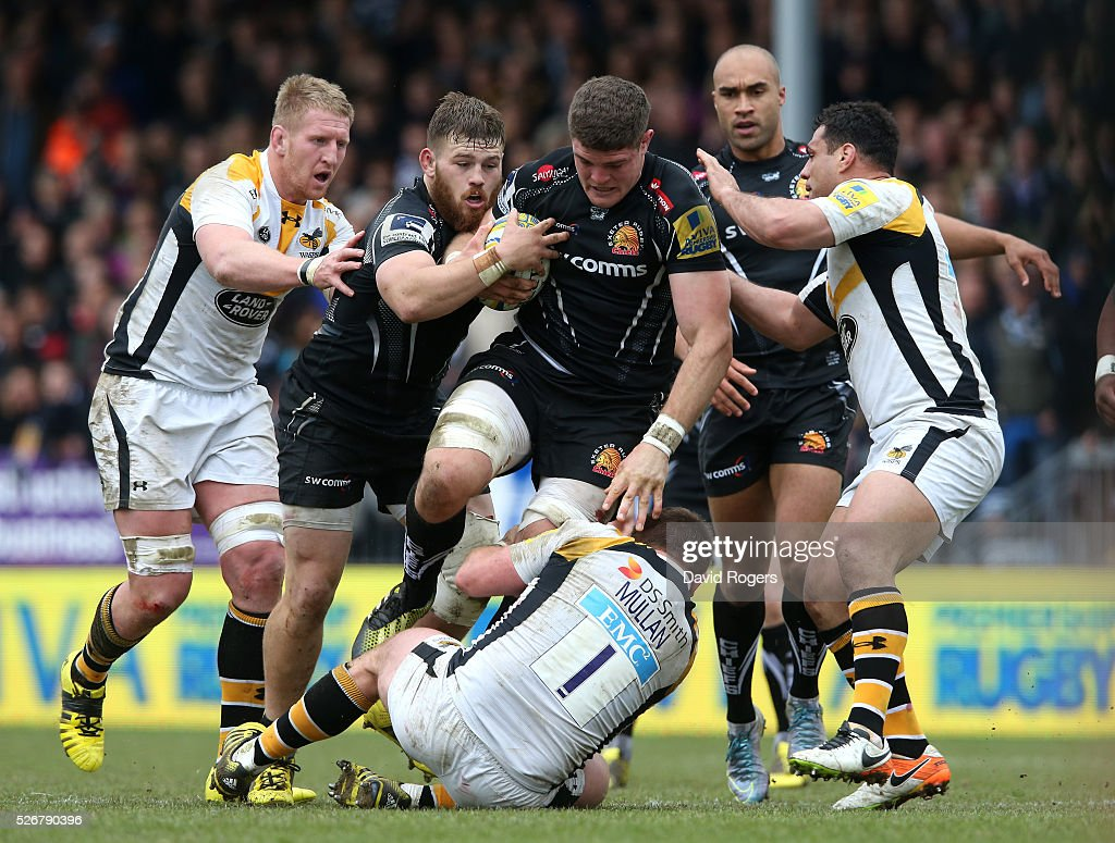 Dave Ewers of Exeter is tackled by <a gi-track='captionPersonalityLinkClicked' href=/galleries/search?phrase=Matt+Mullan&family=editorial&specificpeople=705828 ng-click='$event.stopPropagation()'>Matt Mullan</a> and George Smith (R) during the Aviva Premiership match between Exeter Chiefs and Wasps at Sandy Park on May 1, 2016 in Exeter, England.