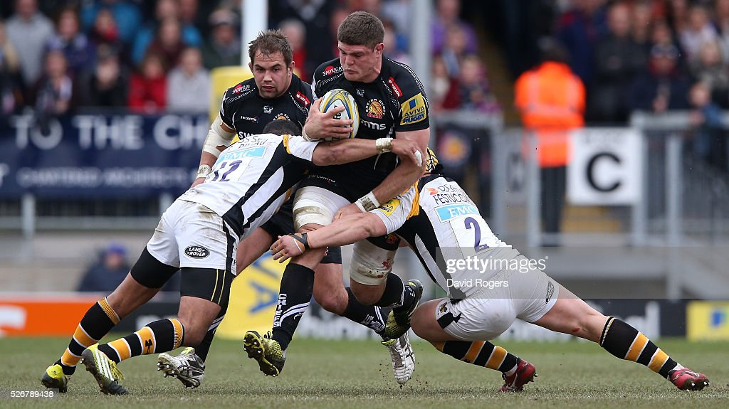 Dave Ewers of Exeter is tackled by <a gi-track='captionPersonalityLinkClicked' href=/galleries/search?phrase=Siale+Piutau&family=editorial&specificpeople=2498975 ng-click='$event.stopPropagation()'>Siale Piutau</a> (L) and <a gi-track='captionPersonalityLinkClicked' href=/galleries/search?phrase=Carlo+Festuccia&family=editorial&specificpeople=2169617 ng-click='$event.stopPropagation()'>Carlo Festuccia</a> during the Aviva Premiership match between Exeter Chiefs and Wasps at Sandy Park on May 1, 2016 in Exeter, England.