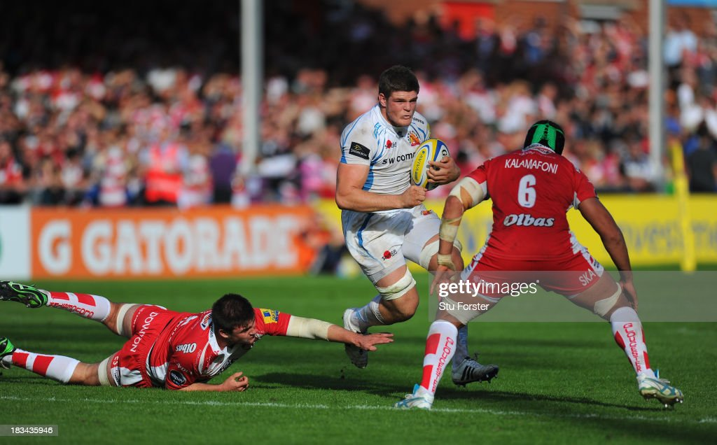 Dave Ewers of Exeter races past Elliott Stooke (l) and Sione Kalamafoni of Gloucester during the Aviva Premiership match between Gloucester and Exeter Chiefs at Kingsholm Stadium on October 6, 2013 in Gloucester, England.