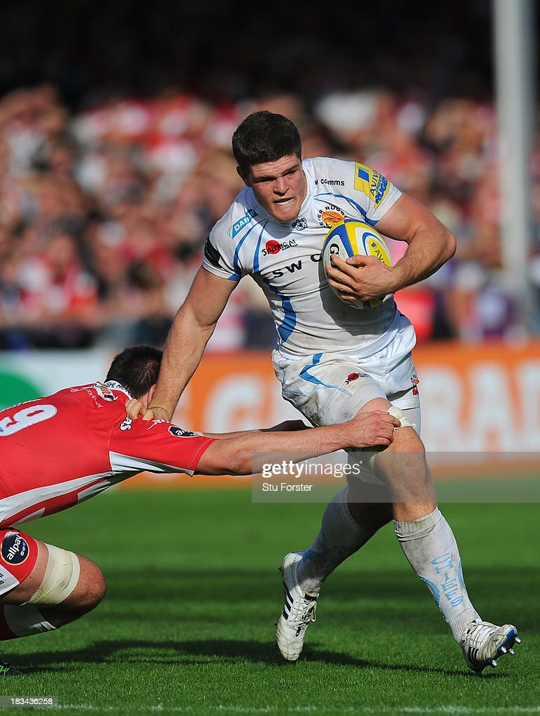 Dave Ewers of Exeter races past Elliott Stooke (l) of Gloucester during the Aviva Premiership match between Gloucester and Exeter Chiefs at Kingsholm Stadium on October 6, 2013 in Gloucester, England.