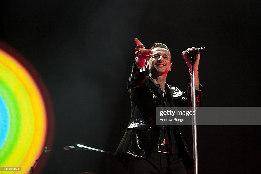<a gi-track='captionPersonalityLinkClicked' href=/galleries/search?phrase=Dave+Gahan&family=editorial&specificpeople=537515 ng-click='$event.stopPropagation()'>Dave Gahan</a> of Depeche Mode performs on stage at First Direct Arena on November 13, 2013 in Leeds, United Kingdom.