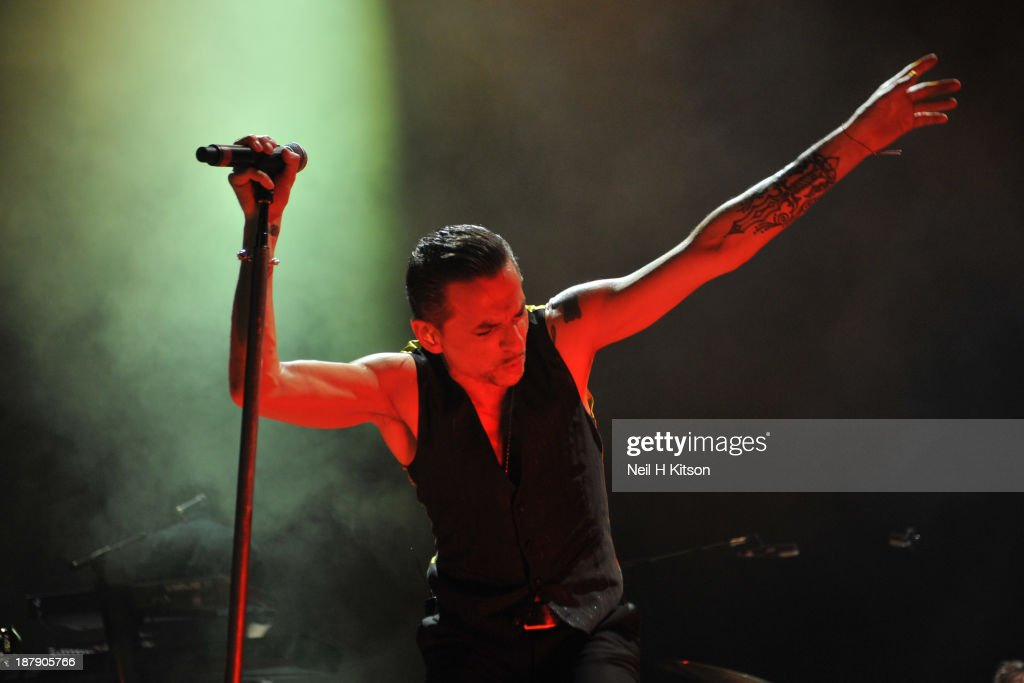 <a gi-track='captionPersonalityLinkClicked' href=/galleries/search?phrase=Dave+Gahan&family=editorial&specificpeople=537515 ng-click='$event.stopPropagation()'>Dave Gahan</a> of Depeche Mode performs on stage at Leeds Arena on November 13, 2013 in Leeds, England.