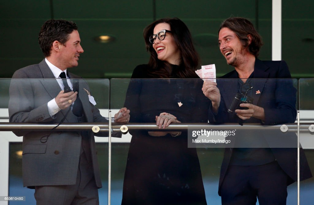 Dave Gardner, Liv Tyler and Darren Strowger watch the racing as they attend day 2 'Ladies Day' of the Cheltenham Festival at Cheltenham Racecourse on March 15, 2017 in Cheltenham, England.