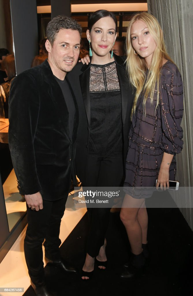 Dave Gardner, Liv Tyler and Ella Richards attend the launch of the KATE MOSS X ARA VARTANIAN collection on May 17, 2017 in London, England.