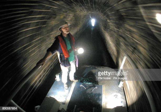 Dave Green from British Waterways rides through the Standege Tunnel on the Huddersfield Narrow Canal which reopened after lying derelict for 57 years...