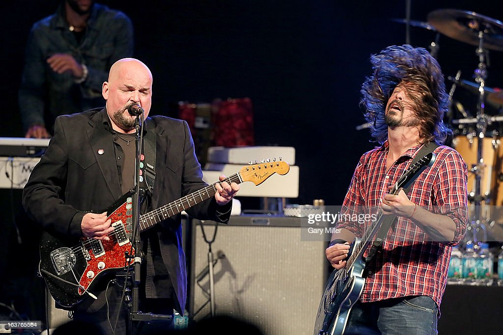 Dave Grohl (R) and Alain Johannes perform in concert at the Sound City showcase at Stubbs BBQ during the South By Southwest Music Festival on March 14, 2013 in Austin, Texas.