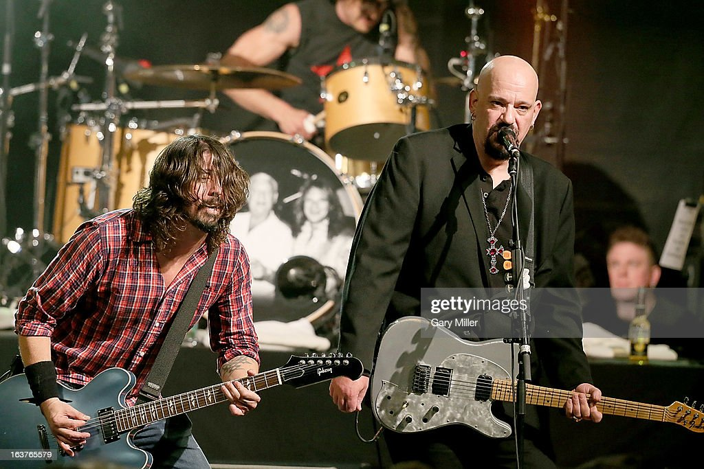 Dave Grohl (L) and Chris Gros perform in concert at the Sound City showcase at Stubbs BBQ during the South By Southwest Music Festival on March 14, 2013 in Austin, Texas.