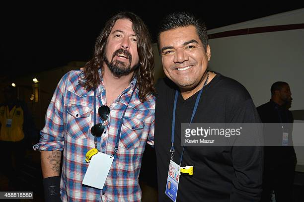 Dave Grohl and George Lopez pose backstage at 'The Concert For Valor' at The National Mall on November 11 2014 in Washington DC