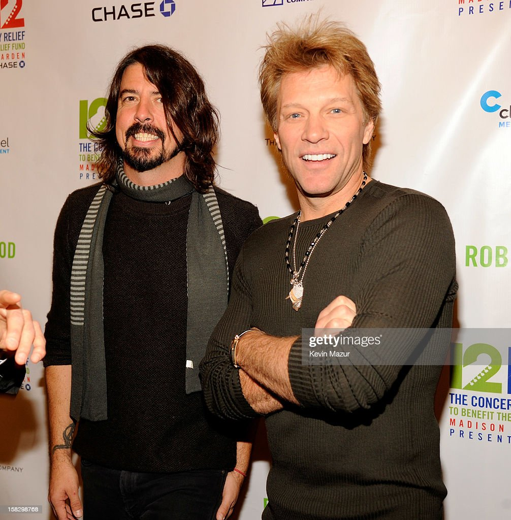 Dave Grohl and Jon Bon Jovi backstage during '12-12-12' a concert benefiting The Robin Hood Relief Fund to aid the victims of Hurricane Sandy presented by Clear Channel Media & Entertainment, The Madison Square Garden Company and The Weinstein Company>> at Madison Square Garden on December 12, 2012 in New York City.