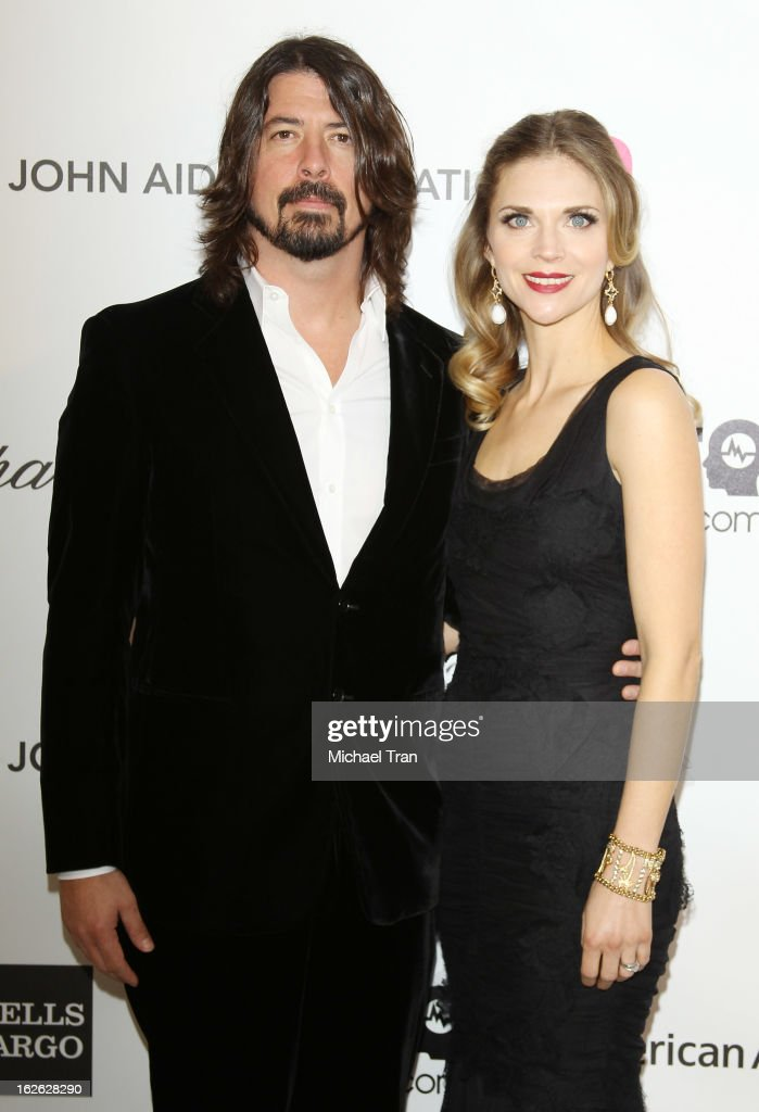 <a gi-track='captionPersonalityLinkClicked' href=/galleries/search?phrase=Dave+Grohl&family=editorial&specificpeople=202539 ng-click='$event.stopPropagation()'>Dave Grohl</a> (L) and Jordyn Blum arrive at the 21st Annual Elton John AIDS Foundation Academy Awards viewing party held at West Hollywood Park on February 24, 2013 in West Hollywood, California.
