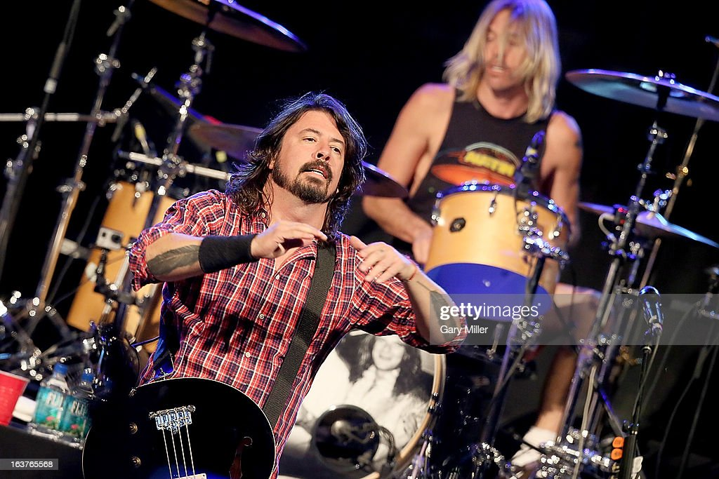 <a gi-track='captionPersonalityLinkClicked' href=/galleries/search?phrase=Dave+Grohl&family=editorial&specificpeople=202539 ng-click='$event.stopPropagation()'>Dave Grohl</a> (L) and <a gi-track='captionPersonalityLinkClicked' href=/galleries/search?phrase=Taylor+Hawkins&family=editorial&specificpeople=220594 ng-click='$event.stopPropagation()'>Taylor Hawkins</a> perform in concert at the Sound City showcase at Stubbs BBQ during the South By Southwest Music Festival on March 14, 2013 in Austin, Texas.