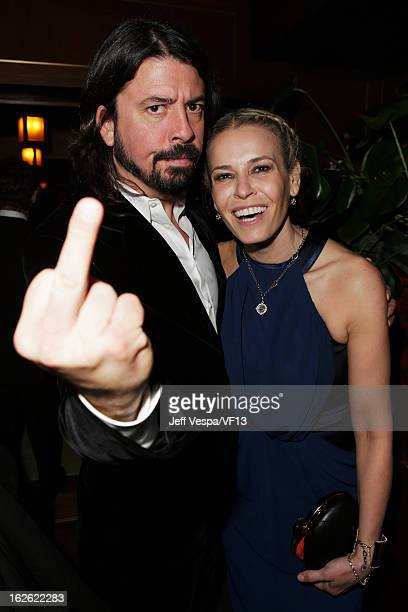 Dave Grohl and TV Personality Chelsea Handler attend the 2013 Vanity Fair Oscar Party hosted by Graydon Carter at Sunset Tower on February 24 2013 in...