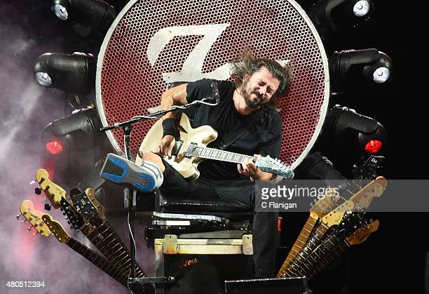 Dave Grohl of The Foo Fighters performs during a major rainstorm at the 2015 Festival D'ete De Quebec on July 11 2015 in Quebec City Canada
