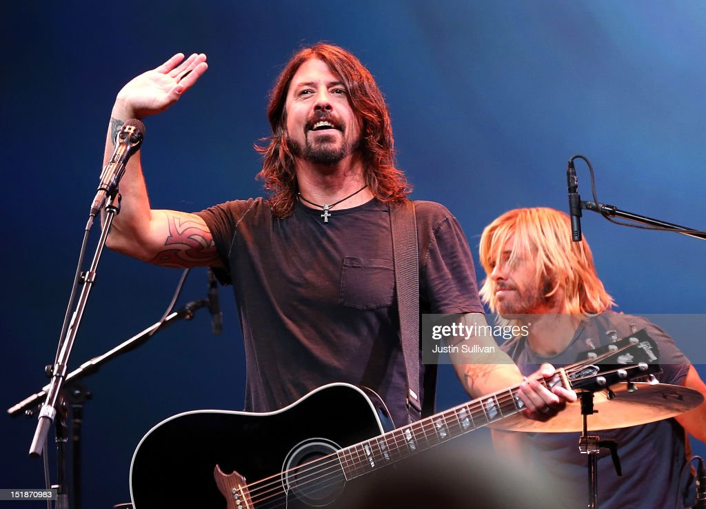 <a gi-track='captionPersonalityLinkClicked' href=/galleries/search?phrase=Dave+Grohl&family=editorial&specificpeople=202539 ng-click='$event.stopPropagation()'>Dave Grohl</a> of the Foo Fighters performs during an Apple special event at the Yerba Buena Center for the Arts on September 12, 2012 in San Francisco, California. Apple announced the iPhone 5, the latest version of the popular smart phone.