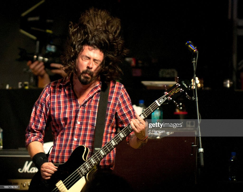 <a gi-track='captionPersonalityLinkClicked' href=/galleries/search?phrase=Dave+Grohl&family=editorial&specificpeople=202539 ng-click='$event.stopPropagation()'>Dave Grohl</a> of the Foo Fighters performs with the Sound City Players at Stubb's Outdoor Arena on March 14, 2013 in Austin, Texas.