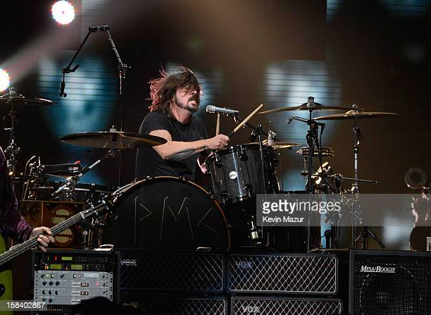 Dave Grohl performs at '121212' a concert benefiting The Robin Hood Relief Fund to aid the victims of Hurricane Sandy presented by Clear Channel...