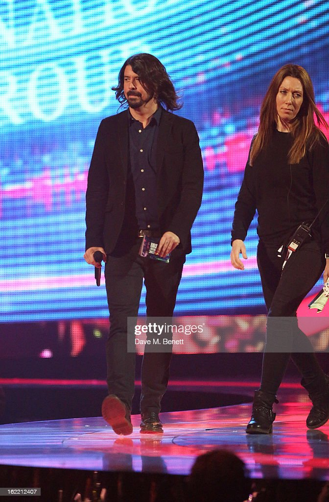 <a gi-track='captionPersonalityLinkClicked' href=/galleries/search?phrase=Dave+Grohl&family=editorial&specificpeople=202539 ng-click='$event.stopPropagation()'>Dave Grohl</a> presents at the Brit Awards at 02 Arena on February 20, 2013 in London, England.