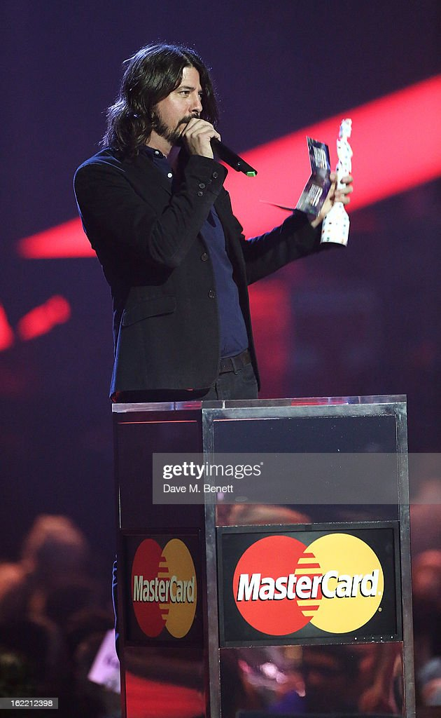 <a gi-track='captionPersonalityLinkClicked' href=/galleries/search?phrase=Dave+Grohl&family=editorial&specificpeople=202539 ng-click='$event.stopPropagation()'>Dave Grohl</a> presents on stage at the Brit Awards at 02 Arena on February 20, 2013 in London, England.