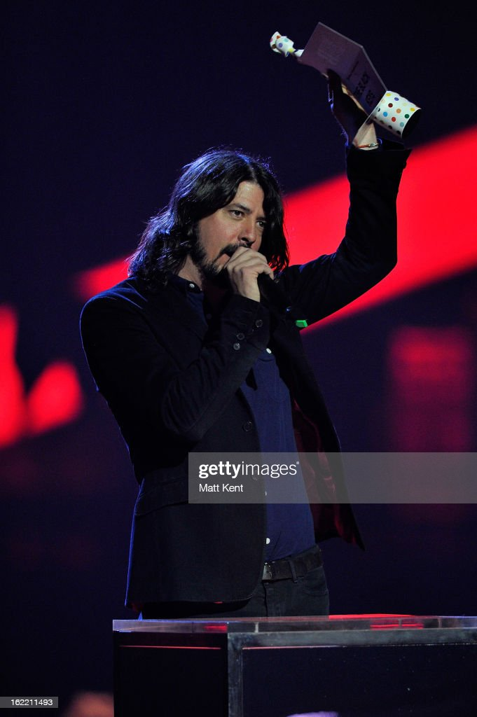 <a gi-track='captionPersonalityLinkClicked' href=/galleries/search?phrase=Dave+Grohl&family=editorial&specificpeople=202539 ng-click='$event.stopPropagation()'>Dave Grohl</a> presents the award Best International Group on stage during the Brit Awards 2013 at the 02 Arena on February 20, 2013 in London, England.