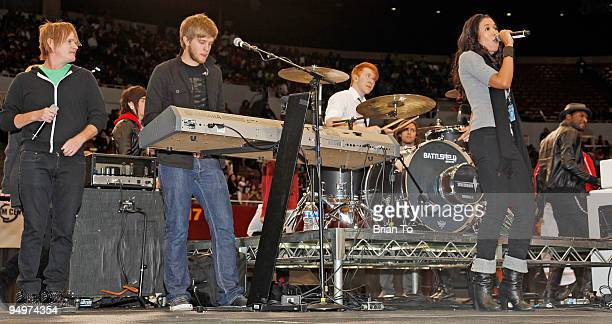 Dave Hanley Joel Bodker and Sada Jackson from the music group Press Play perform at 'Christmas In The City' Charity Toy Drive at LA Sports Arena on...