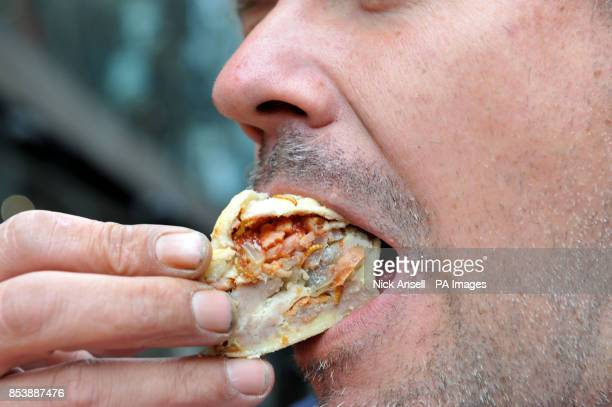 Dave Hansen tries a meal worm pie at Rentokil's Popup Pestaurant at One New Change central London