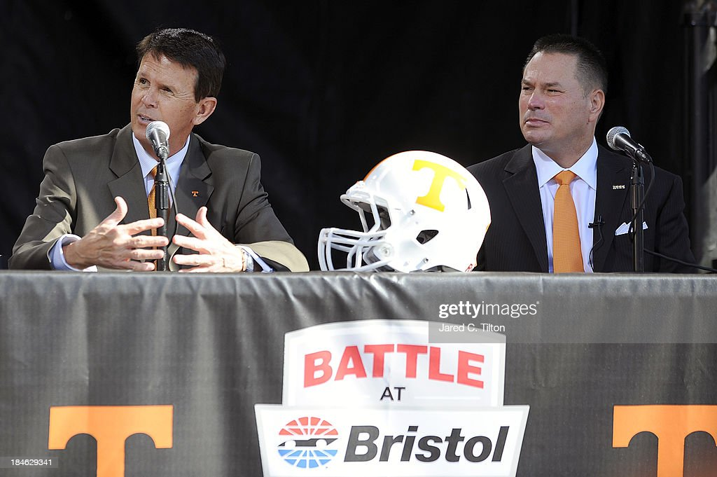 Dave Hart Tennessee Vice Chancellor/Athletic Director and Butch Jones Tennessee Head Coach speak during a press conference at Bristol Motor Speedway...