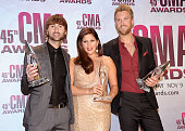 Dave Haywood Hillary Scott and Charles Kelley of Lady Antebellum pose with awards at the 45th annual CMA Awards at the Bridgestone Arena on November...