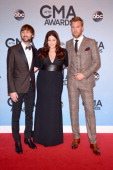 Dave Haywood Hillary Scott and Charles Kelley of Lady Antebellum attend the 47th annual CMA Awards at the Bridgestone Arena on November 6 2013 in...