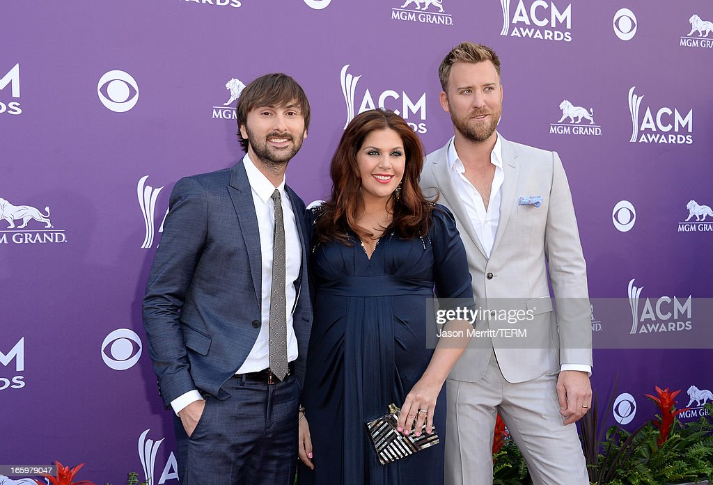 Dave Haywood, Hillary Scott, and Charles Kelley of music group Lady Antebellum arrive at the 48th Annual Academy of Country Music Awards at the MGM Grand Garden Arena on April 7, 2013 in Las Vegas, Nevada.