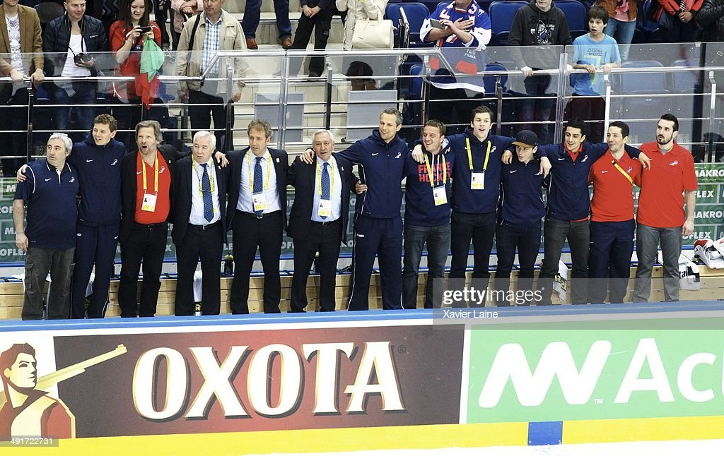 Dave Henderson of France and his staff celebrate the victory during the 2014 IIHF World Championship between France and Norway at Chizhovka arena on may 17,2014 in Minsk, Belarus.