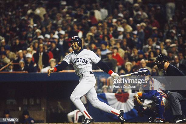 Dave Henderson of the Boston Red Sox follows through his swing during the World Series against the New York Mets at Shea Stadium on October 1986 in...