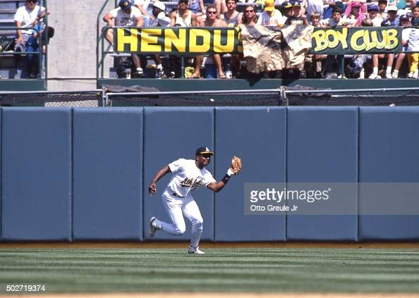 Dave Henderson of the Oakland Athletics catches a fly ball during an MLB game against the Boston Red Sox on April 28 1992 at the Oakland Alameda...