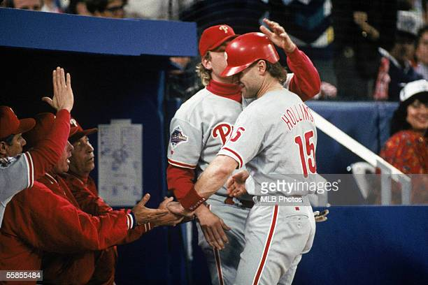 Dave Hollins of the Philadelphia Phillies is congratulated in the dugout during game six of the 1993 World Series against the Toronto Blue Jays at...