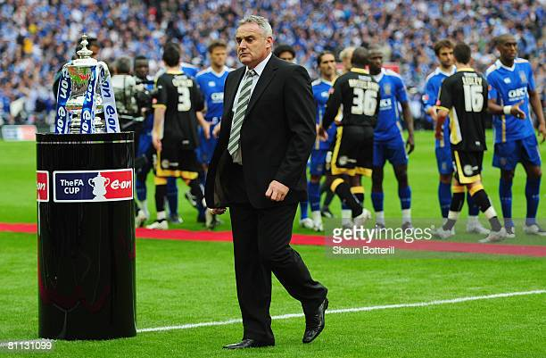 Dave Jones manager of Cardiff City walks past the trophy prior to the FA Cup Final sponsored by EON between Portsmouth v Cardiff City at Wembley...