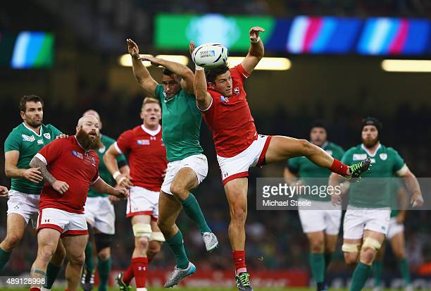 Dave Kearney of Ireland and DTH Van Der Merwe of Canada challenge for the high ball during the 2015 Rugby World Cup Pool D match between Ireland and...
